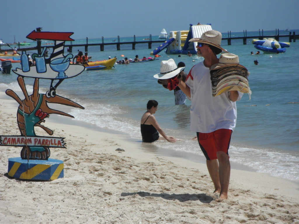 Hat salesman on Cozumel's west side beaches.