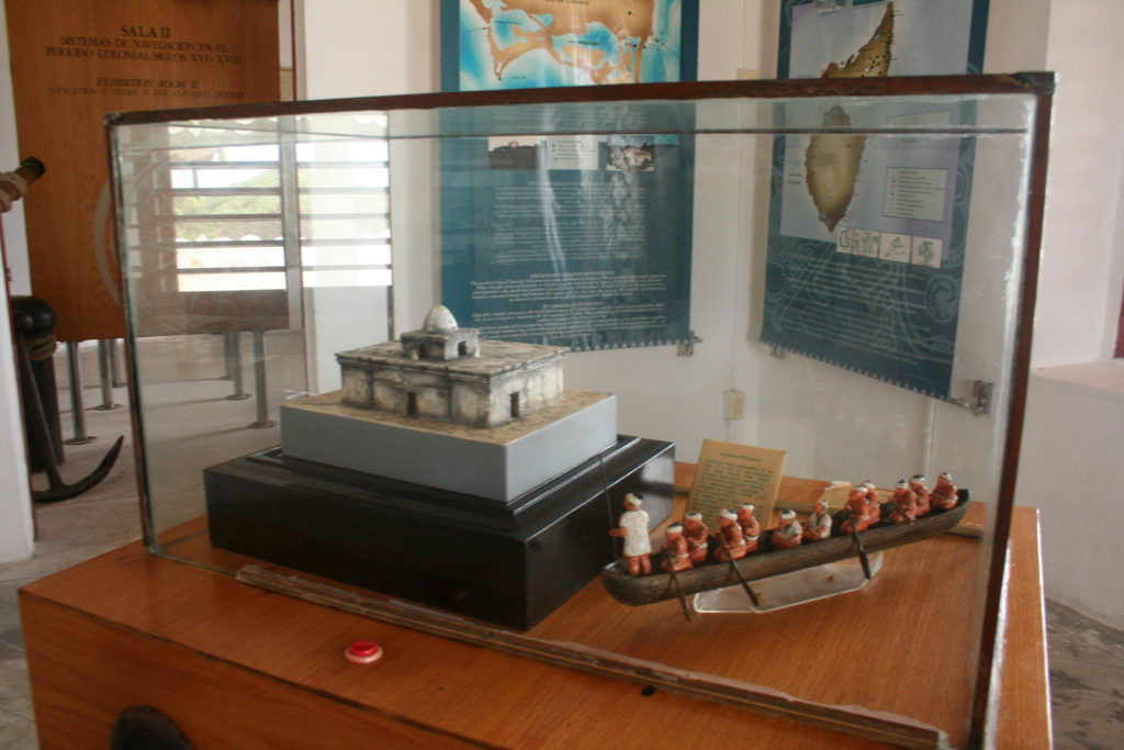 Museum display of old Mayan temple and boat transportation at the lighthouse in Cozumel.