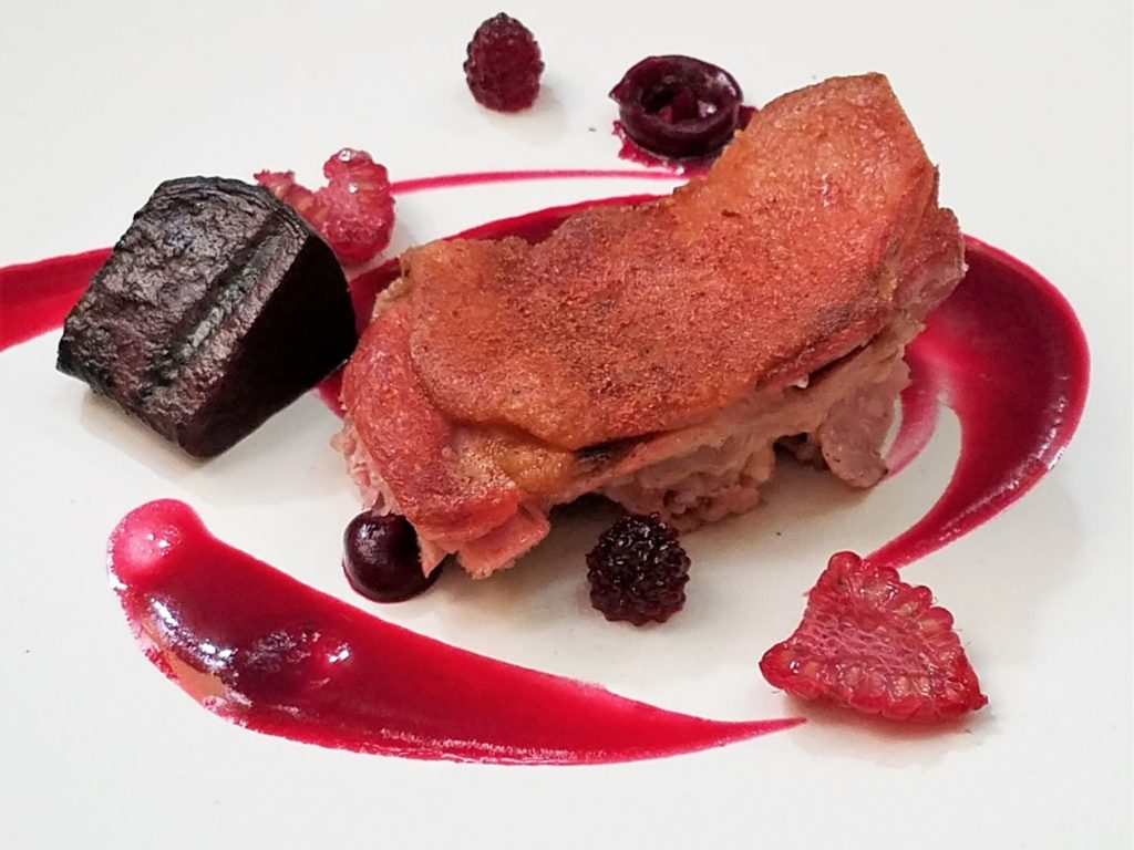 Duck Confit with beet sauce and raspberries at Aperi in San Miguel de Allende, Mexico