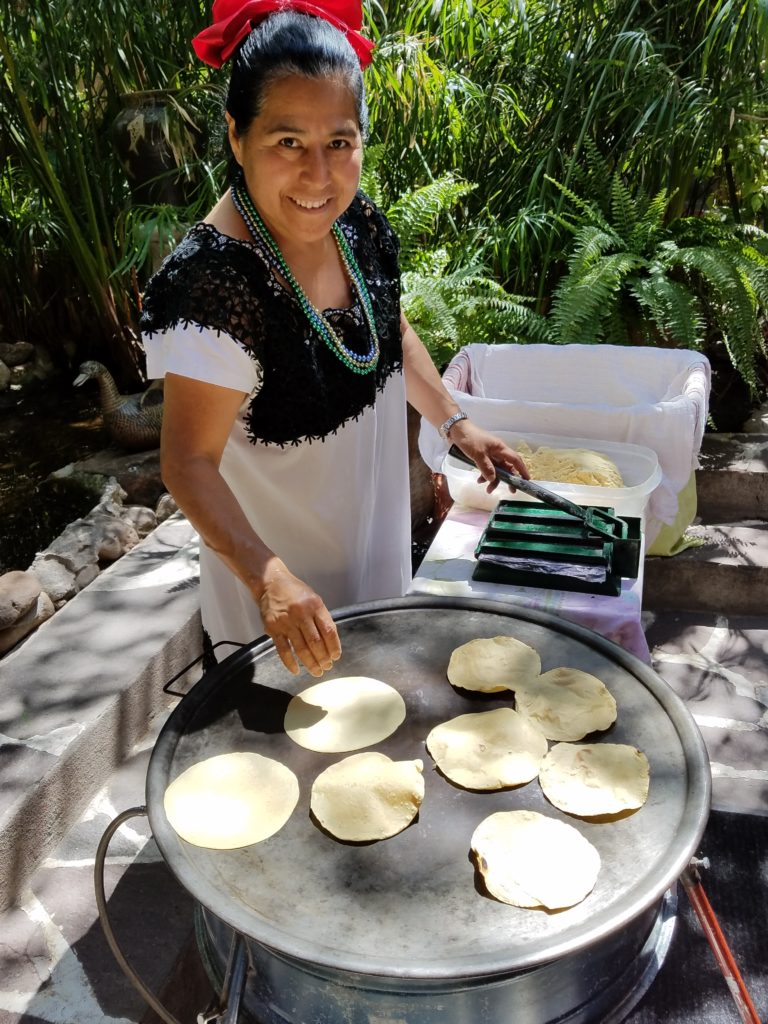Woman making tortillas
