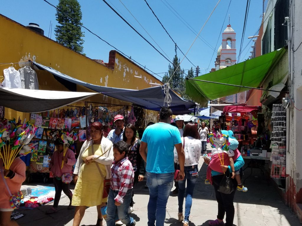 Walking Street with shops and vendors in Santa Rosa Jauregui