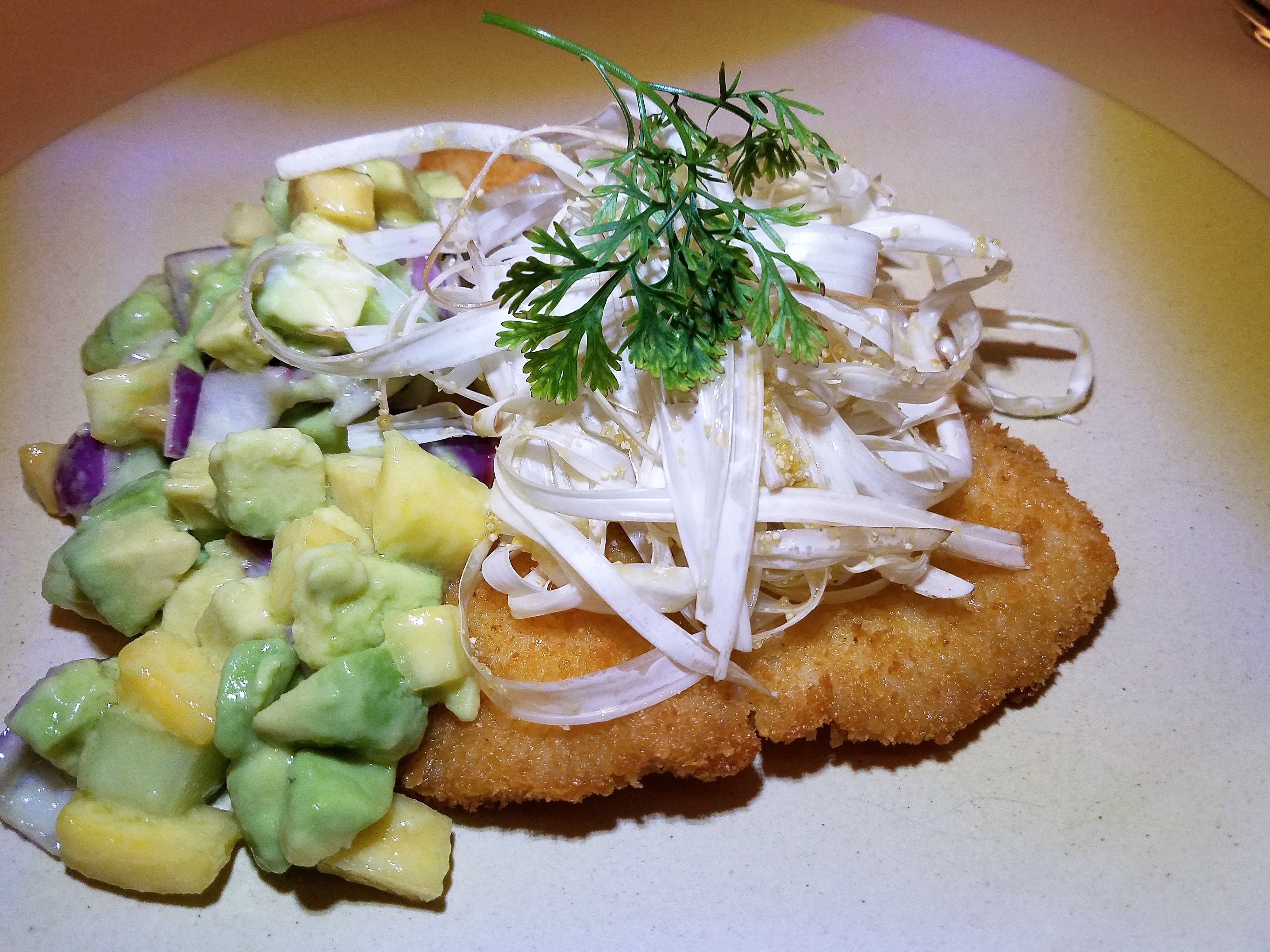 Crusted pan fried Paiche, cocona, cucumber and avocado salad with fresh heart of palms