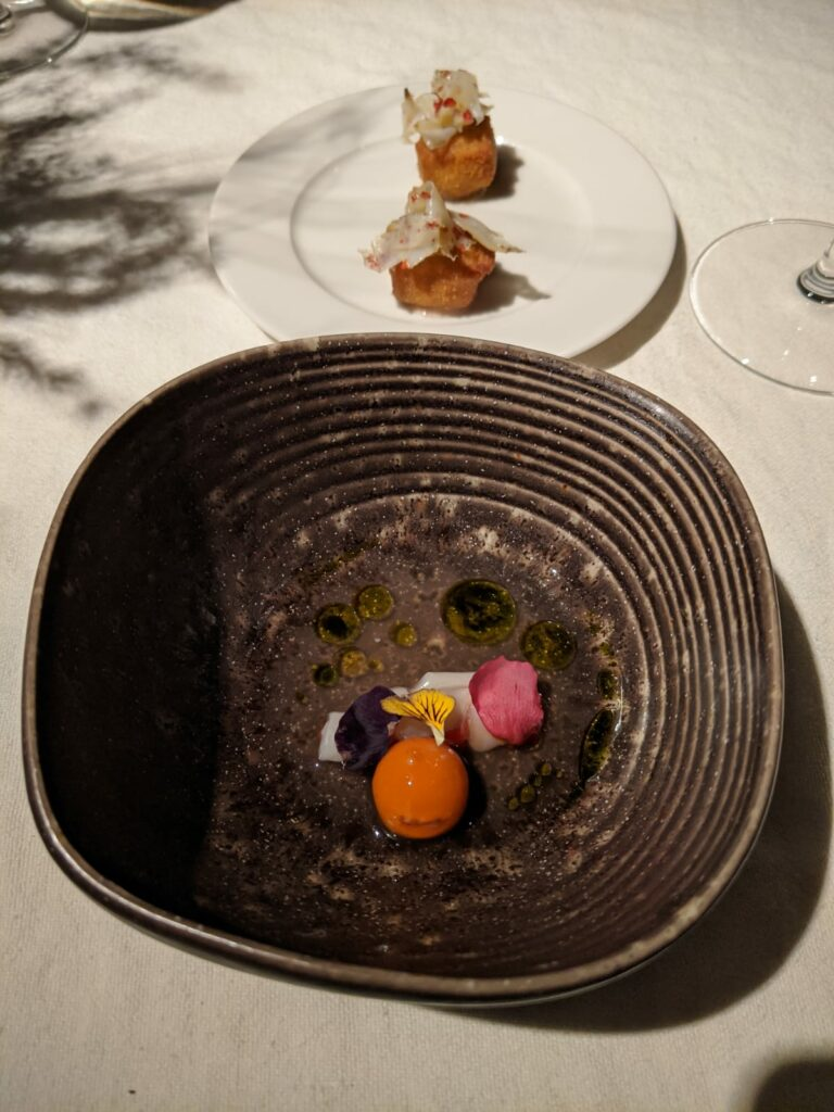 Consome of mortadella with razor clams and tomato sphere, plus soup croquettes and mussels, mortadela mousse and cuttlefish. Hisa Franko