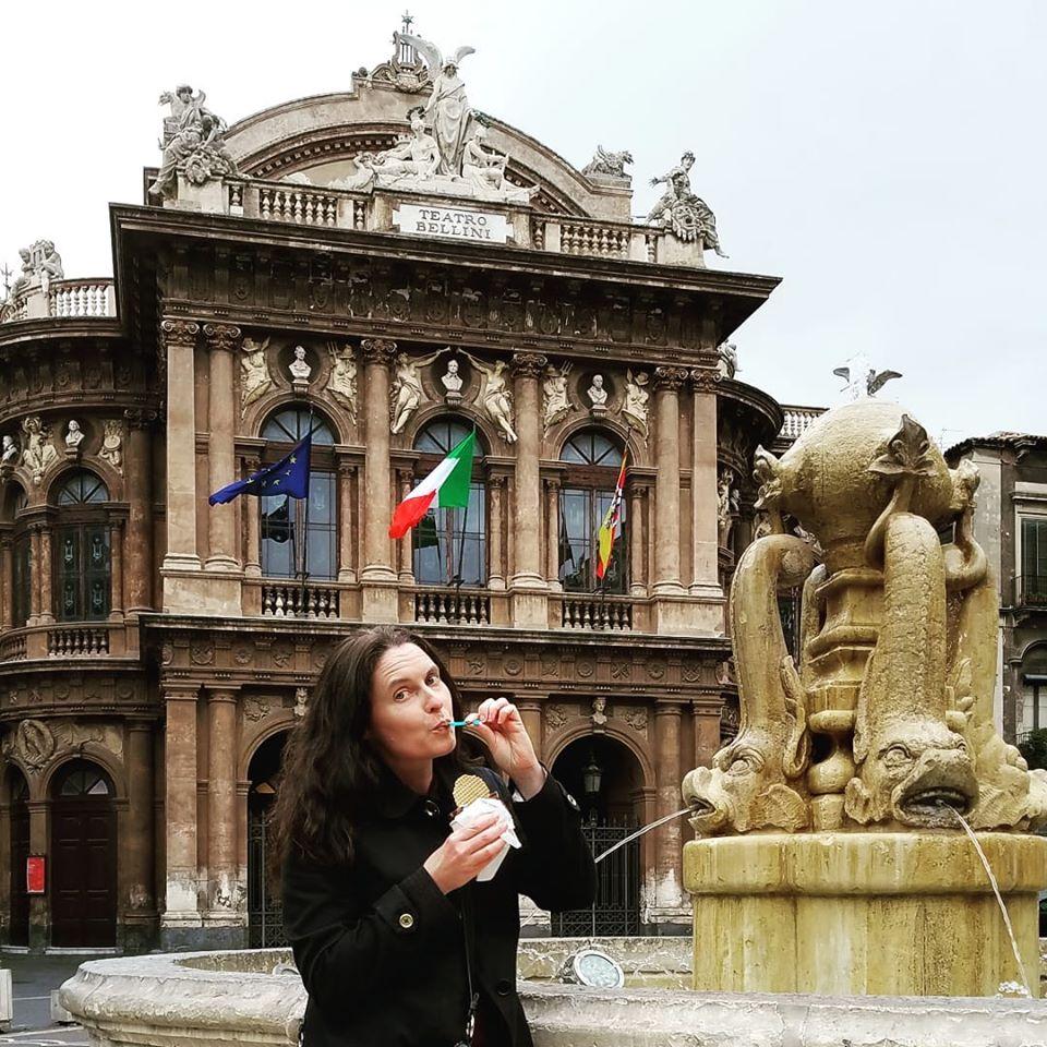 Tiffany eating chocolate gelato by Teatro Bellini, Catania, Sicily