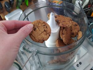 Chocolate chip cookies in a food processor to make cheesecake crust