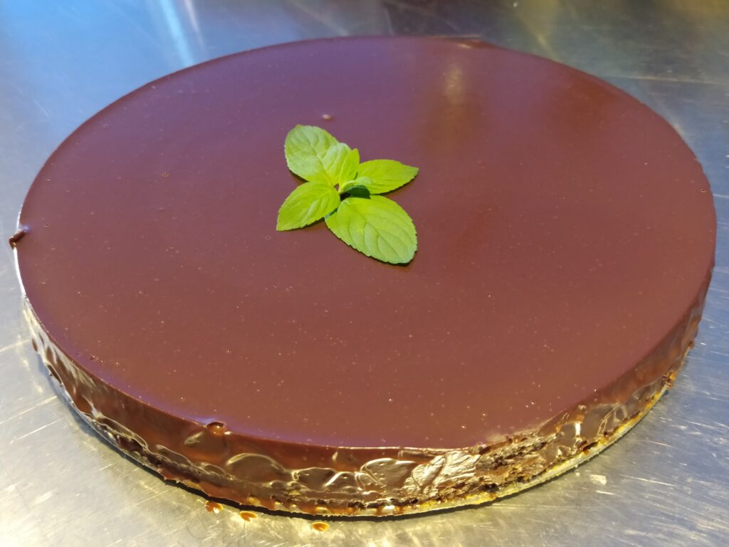 Cheesecake coveres witn mexican chocolate ganache