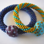 Crochet bead and lamp work bracelet