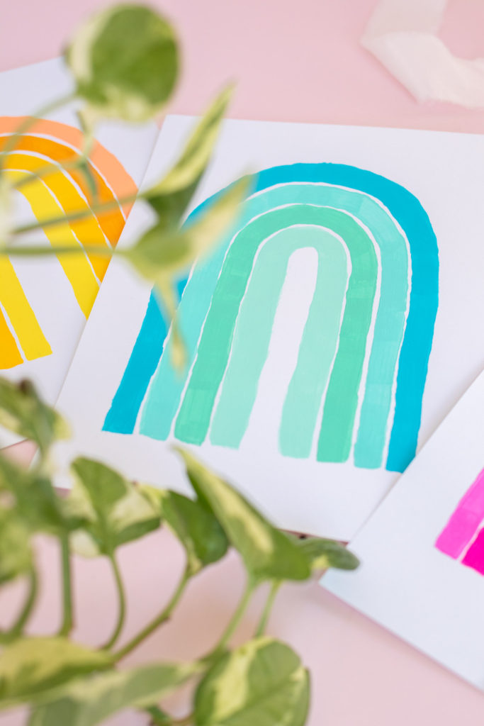 5-Minute Wall Art Idea! DIY Monochromatic Rainbow Art // Decorate with simple hand-painted monochromatic rainbows to make custom wall art in minutes! #wallart #homedecor #rainbows #papercrafts #cardstock #painting #monochromatic