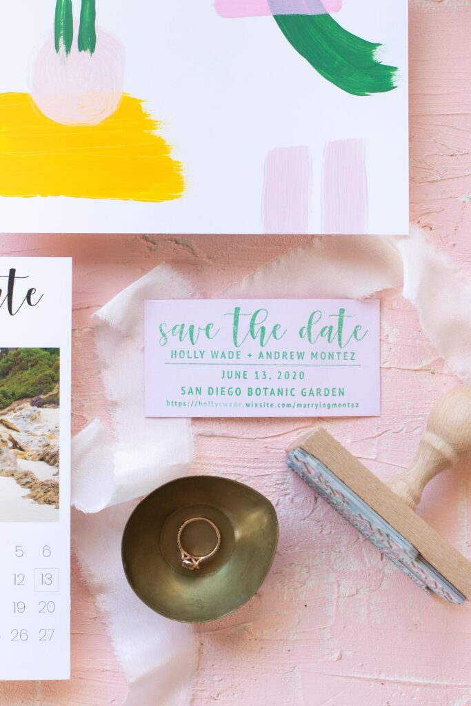 Our DIY Hand-Painted Save the Dates // See how I designed my own wedding save the dates with a hand-painted designs on the backs! Combined with custom stamps, simple magnets and printed envelopes, every element of these save the date invitations feels homemade and personal #weddingdiy #diywedding #weddinginvites #savethedates #papercrafts #handpainted #invitations