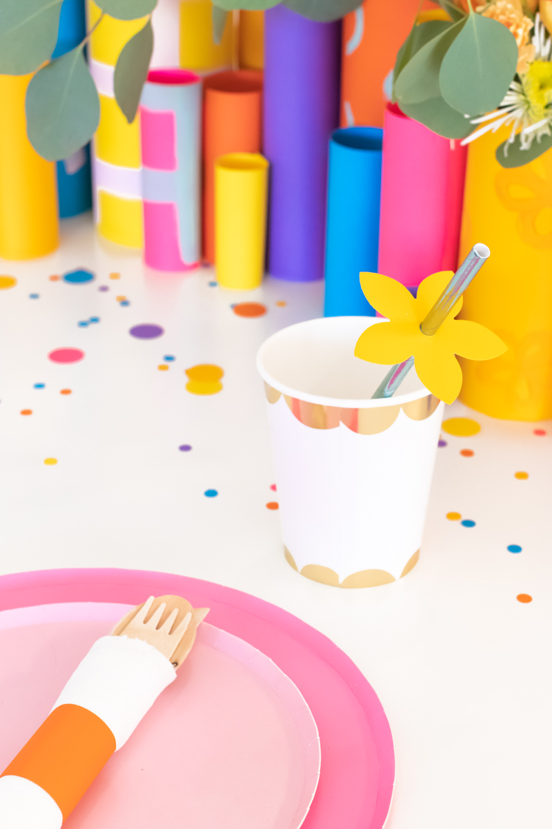 Colorful Spring Party with DIY Paper Decor / Use vibrant Astrobrights cardstock to create a variety of paper party decor for a spring celebration! Whether you're celebrating a Mother's Day brunch, bachelorette weekend or just-because party, thes bright spring party ideas will POP! Make paper wrapped vases as a unique centerpiece accompanied by a paper floral chandelier, floral straws, paper napkin rings and simple homemade confetti #ad #partyideas #springdecor #papercrafts #diyparty #partydecor #paperparty #paperdecor #mothersday #easterbrunch #rainbowparty #floraldecor #birthdayparty #springparty