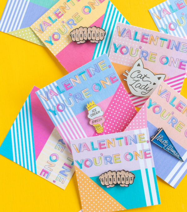 Printable Pin Cards for Galentine's Day // Use this cute 80s-inspired printable valentine to add an enamel pin for a sweet Valentine's Day gift! These colorful pin cards also make excellent Galentine's Day gifts #valentinesday #printable #galentinesday #vdaydiy #valentinesdaycrafts #diyvalentine #giftideas #giftsforwomen