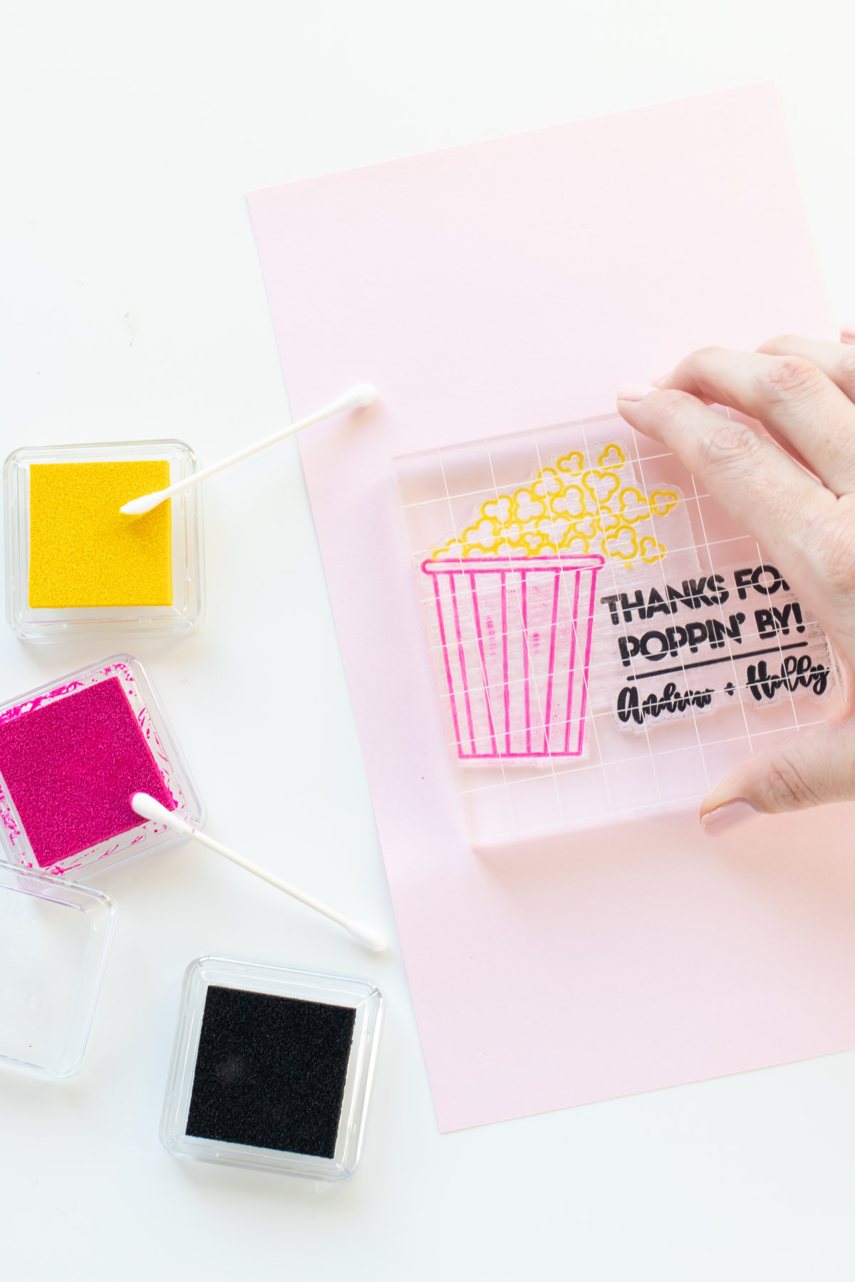 """DIY Stamped Popcorn Favors for Weddings   Make your own DIY wedding favors with microwave popcorn! These cute """"thanks for POPPING by"""" popcorn wedding favors use a custom stamp from RubberStamps.com to make a favor guests can easily enjoy at home! #ad #weddingdiy #weddingfavor #partyfavor #stamping #popcorn #papercrafts #diyparty #handmadewedding #colorfulwedding"""