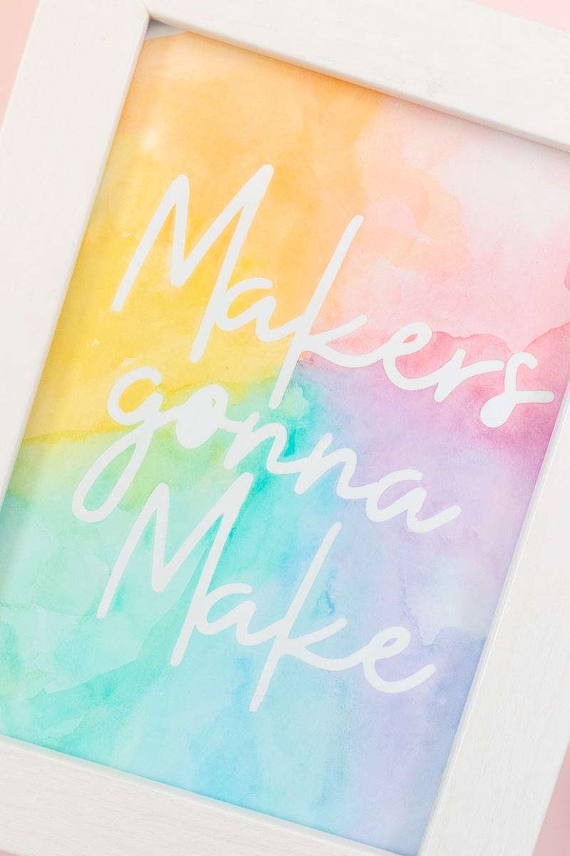 Easy Watercolor Artwork Hack // Follow this quick watercolor tutorial video to learn how to make graphic art that pops off the paper! Using vinyl as a stencil, create rainbow artwork in minutes with simple watercolors! #watercolor #artwork #painting #vinyl #cricutmade #handmadewithjoann #rainbow #wallart #diyideas #diyart