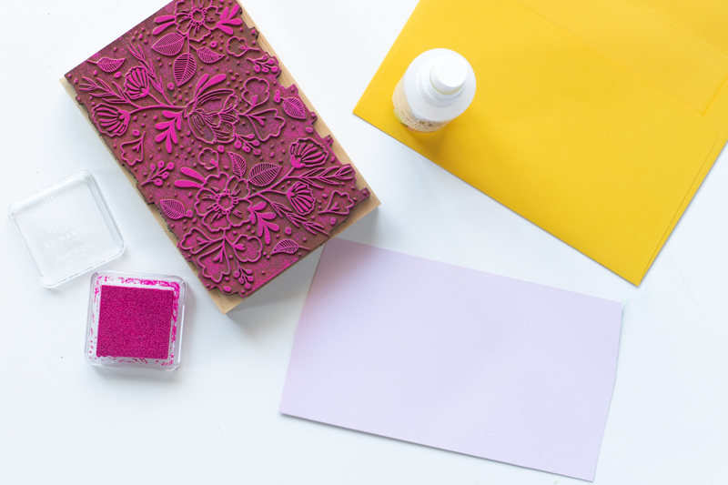 DIY Floral Stamped Envelope Liners // Make DIY wedding stationary with these stamped envelope liners using a large floral stamp and inks from RubberStamps.com! Custom envelope liners are the perfect way to make elegant event stationary. Click through for the easy DIY tutorial #ad #weddingdiy #weddingcrafts #papercrafts #stamping #weddingstationary #diystationary #cardmaking #partydiy