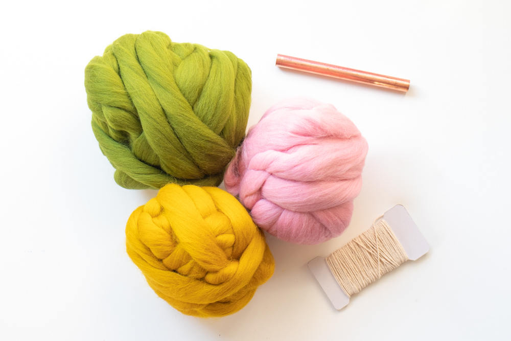 colorful roving, copper pipe and string for weaving project