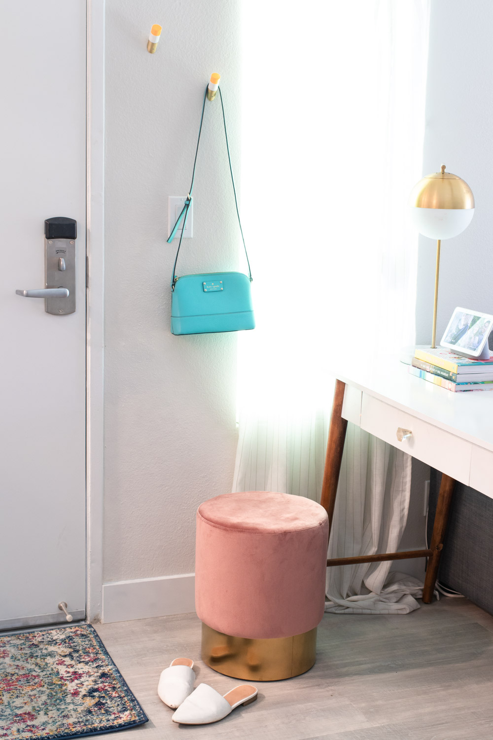 pink ottoman in small space entryway