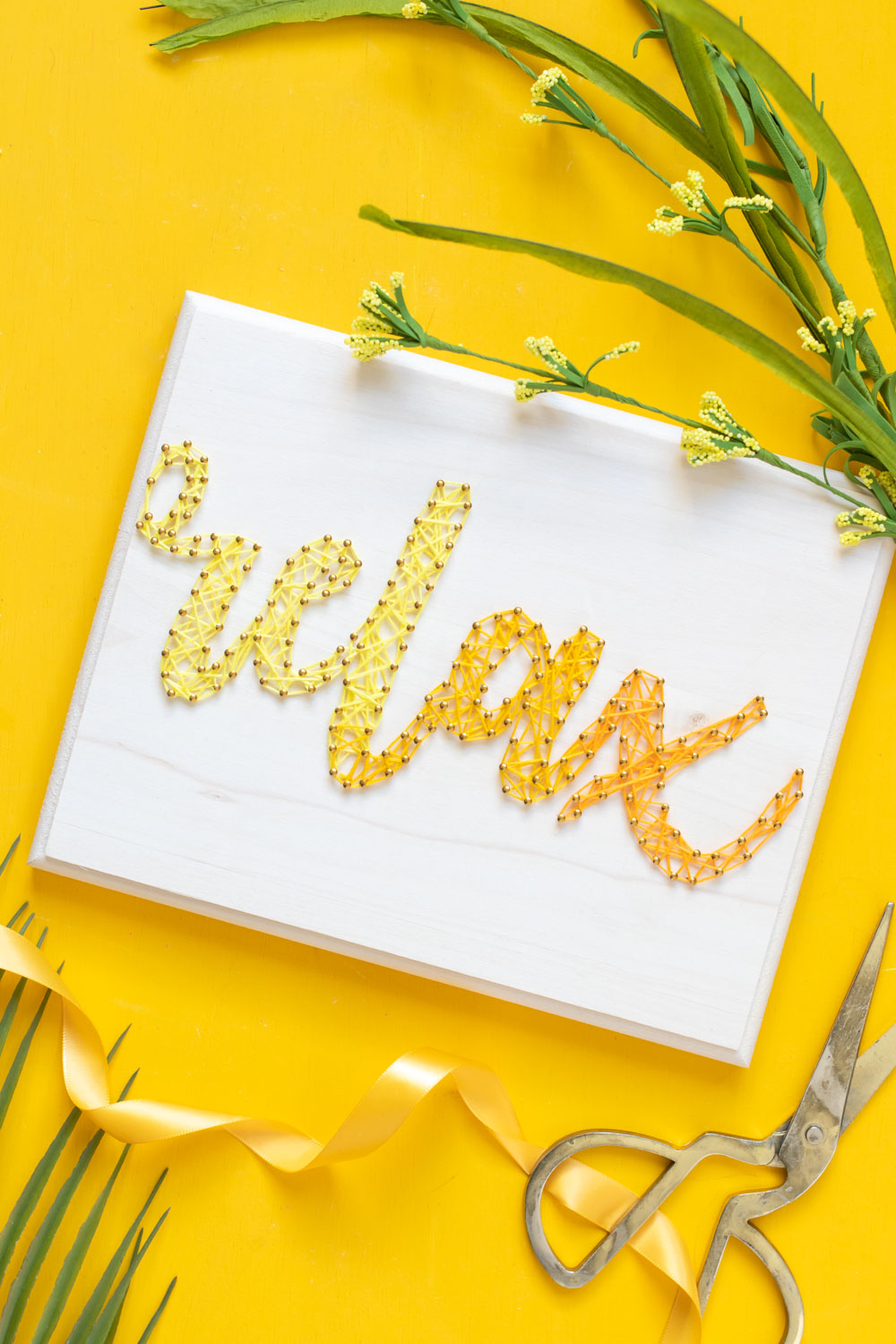 """""""relax"""" graphic string art on yellow background"""