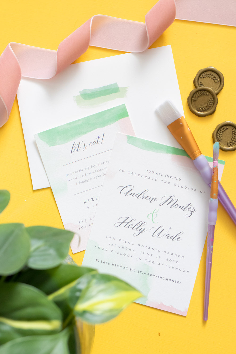 Layered wedding invitations and envelopes