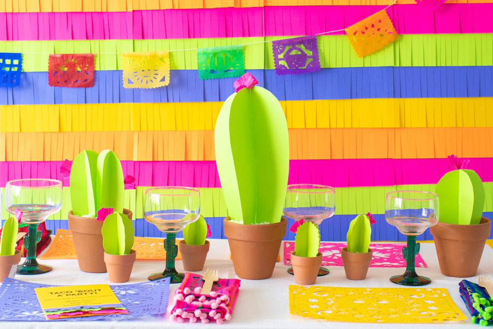 paper fiesta decor with paper cacti, fringe backdrop