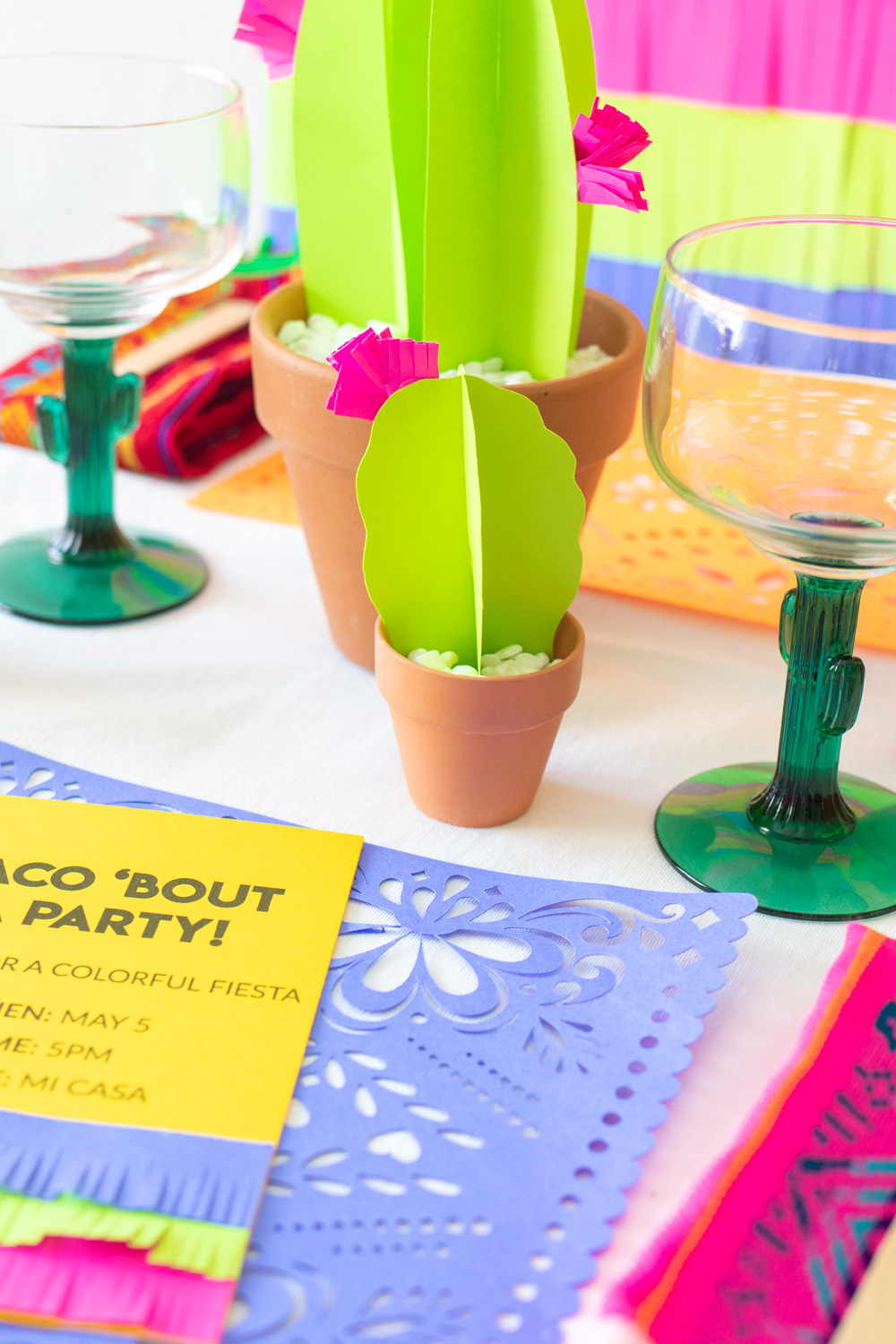 closeup of paper cactus for fiesta decor on table