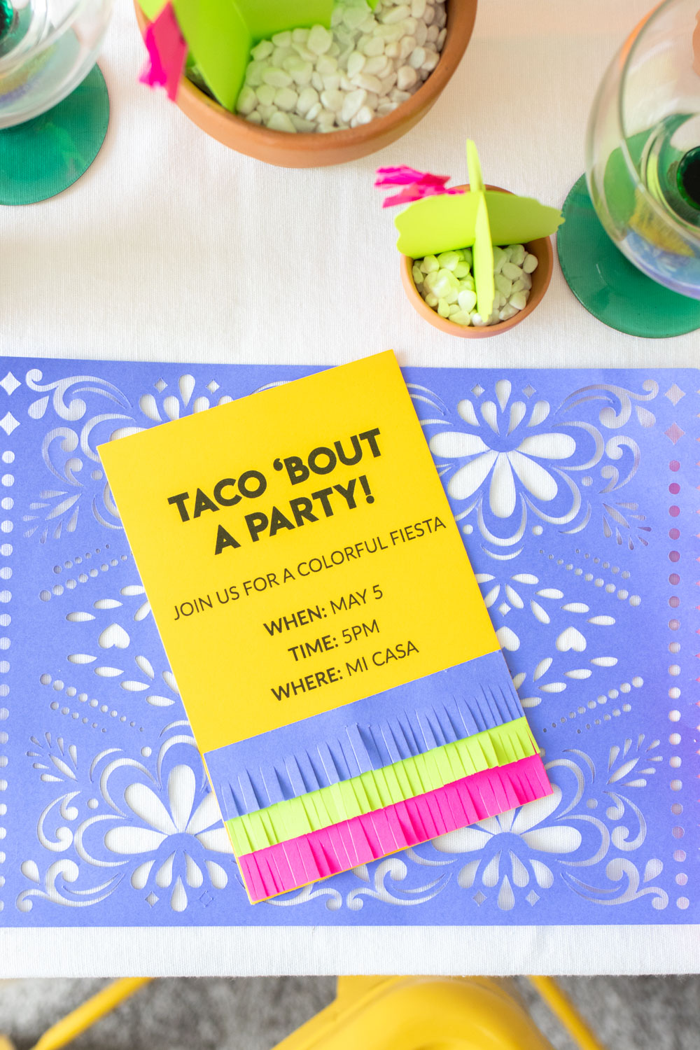fringe invitations for fiesta party on purple placemats
