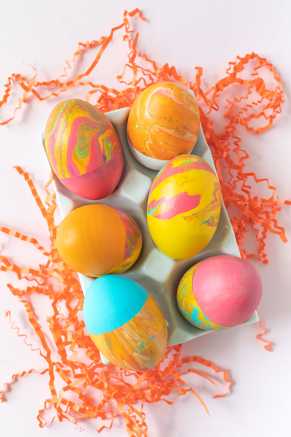 selection of fluid painted easter eggs with color blocking
