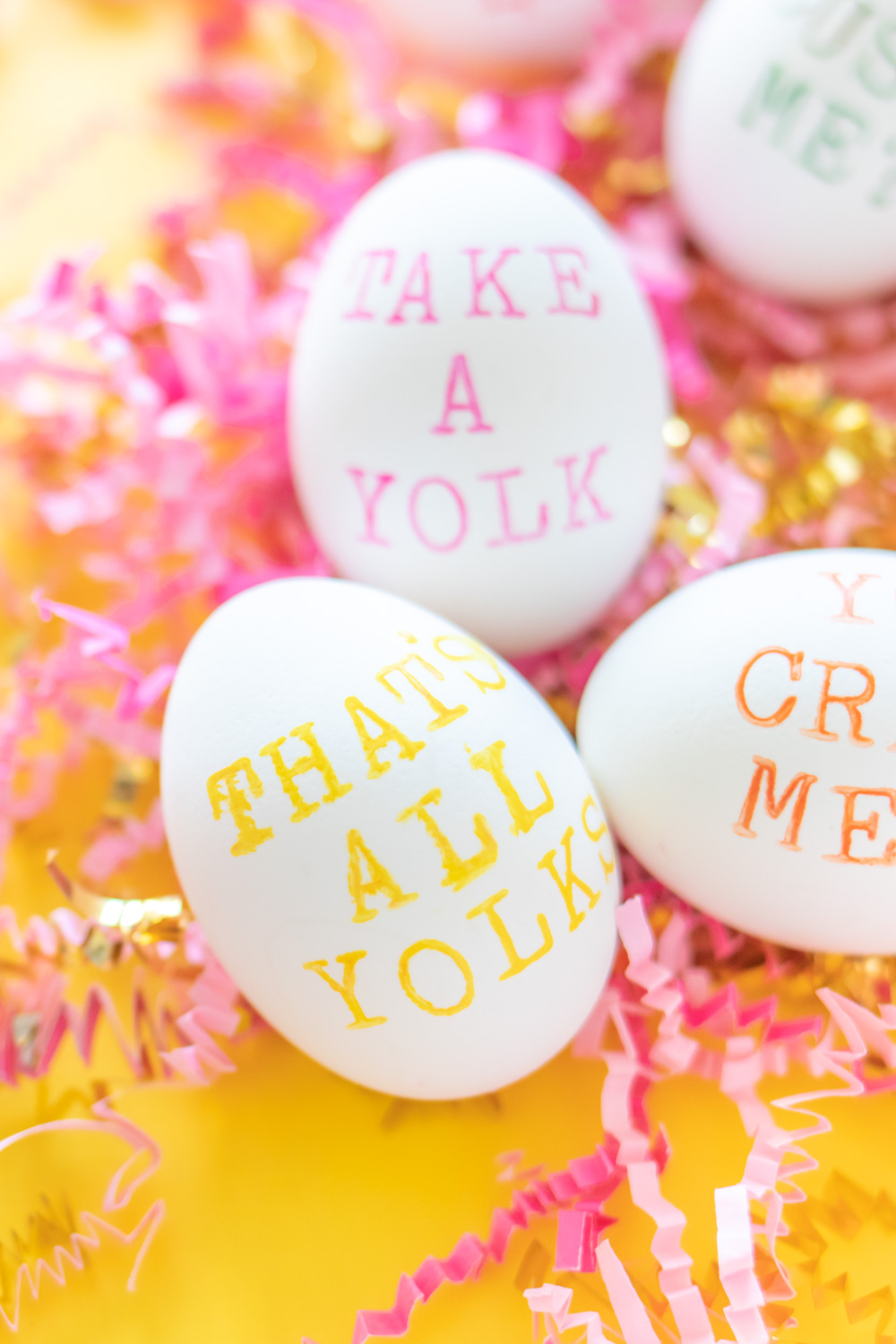 easter egg with punny saying on bed of paper