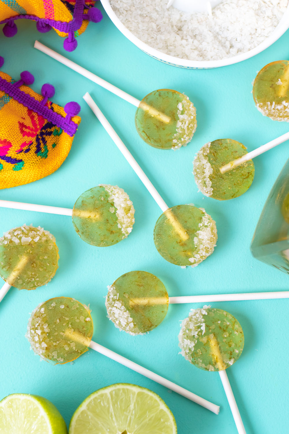 multiple lollipops arranged on teal background