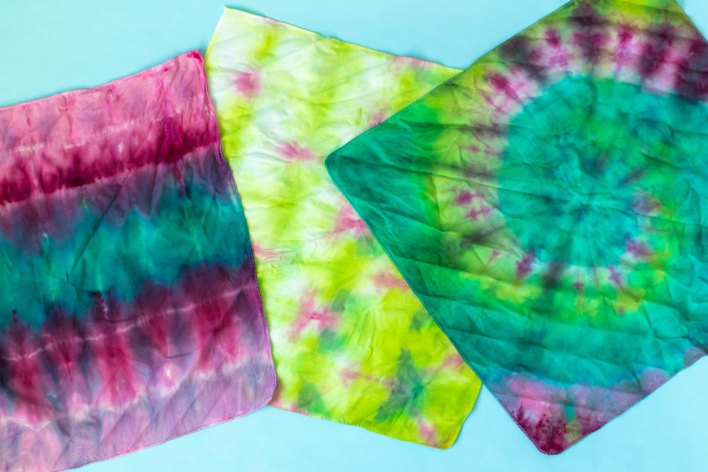 flatlay of three tie dye techniques
