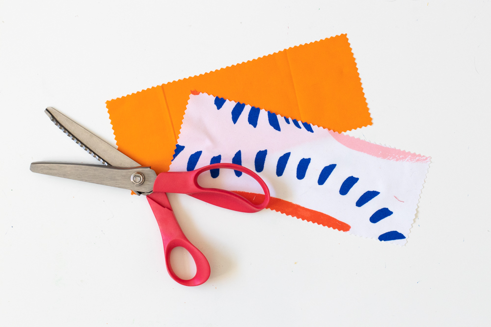 patterned and orange fabric with pinking shears