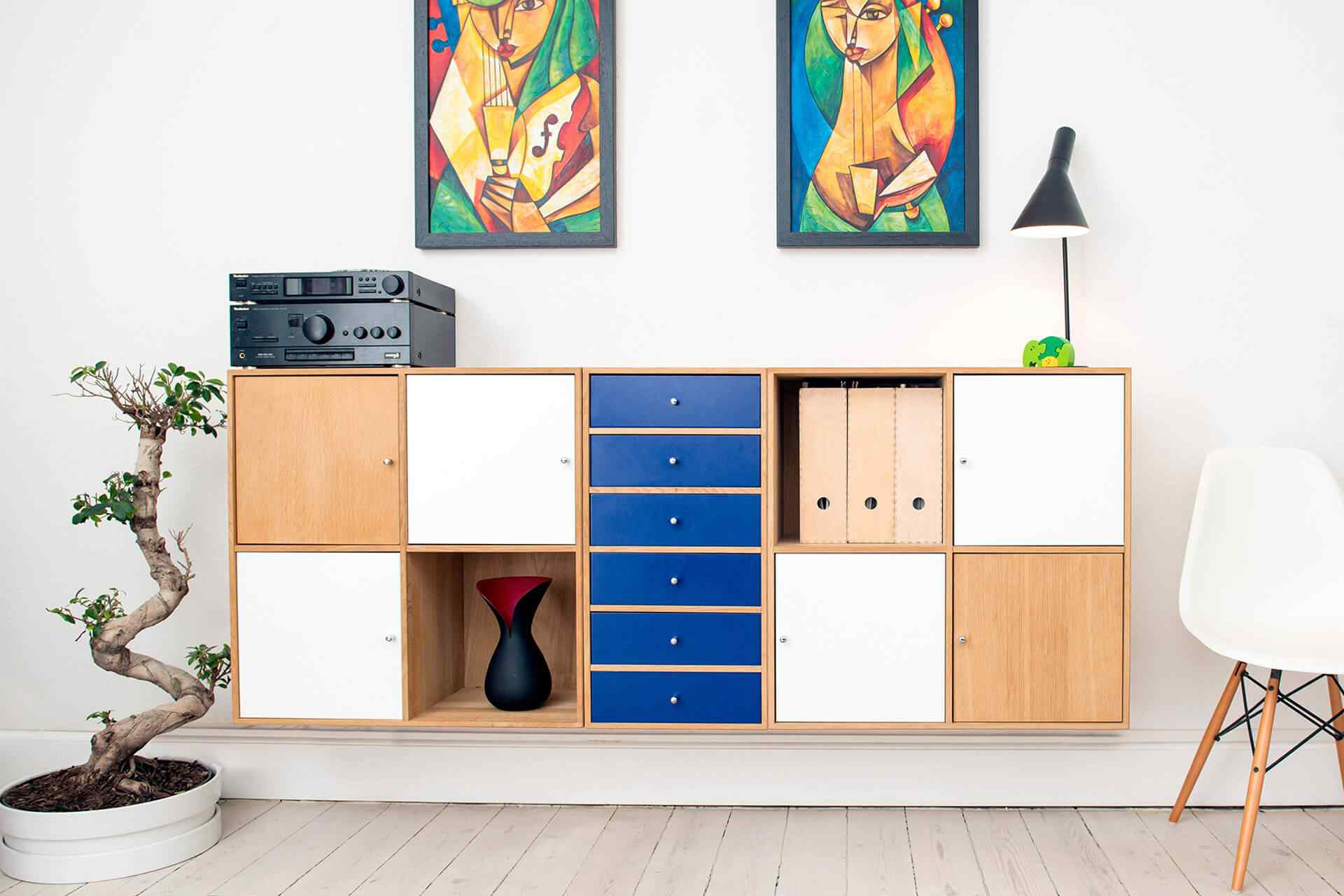 hand crafted multi colored chest of drawers in a modern apartment