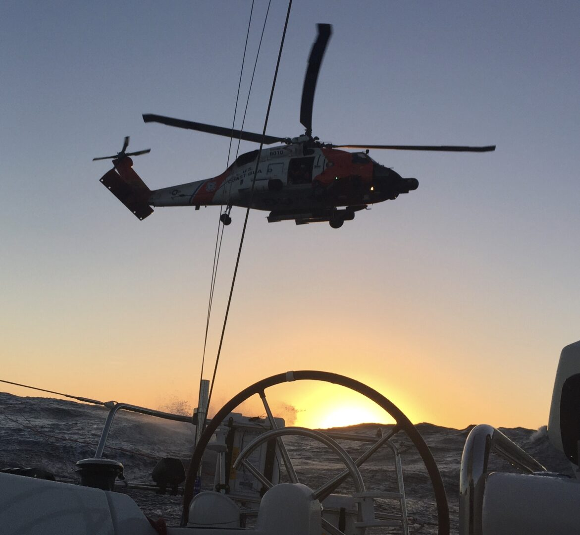 A visit from a USCG helicopter to drop a pump