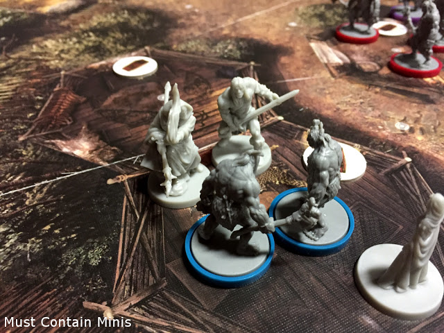 Miniatures fighting in Conan by Monolith Games