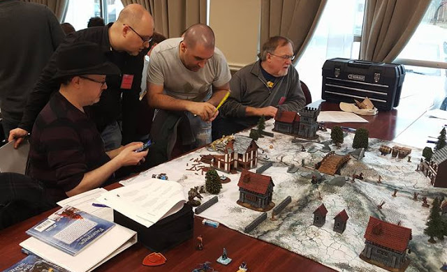 People enjoying Frostgrave at a Convention