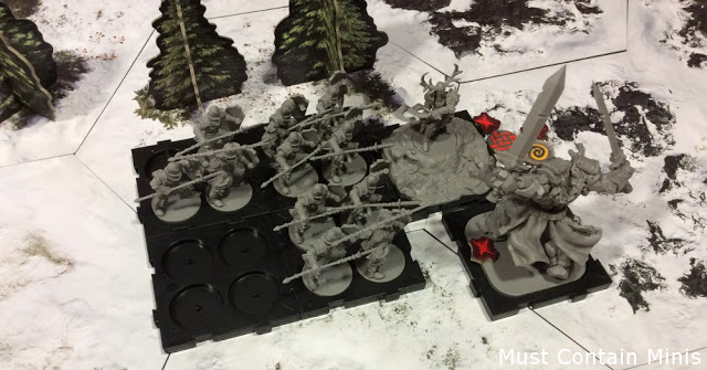 Ardus versus a Golem and bock of Spearmen