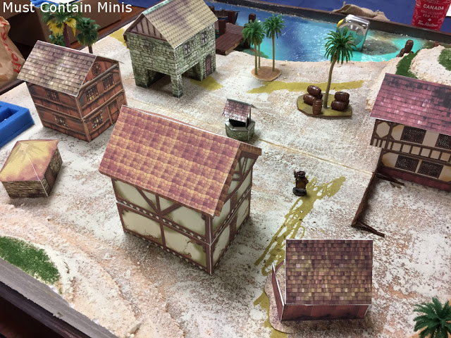 Playing Blood & Plunder on a table with paper buildings / terrain
