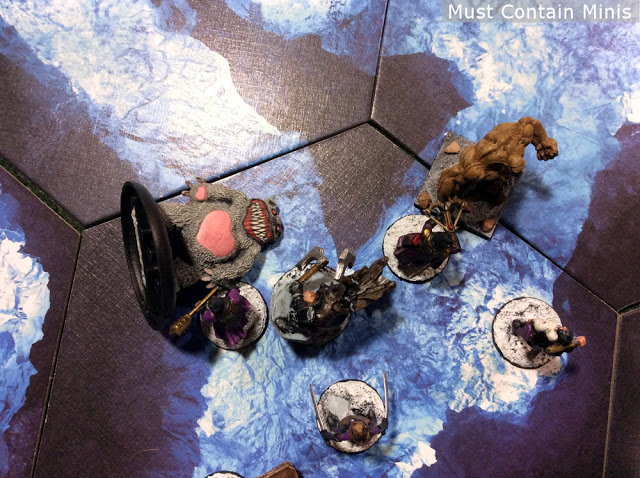The Templar and Captain take out a monster in Frostgrave