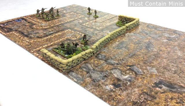 Add 3D terrain to make the card stock battle mat look even better