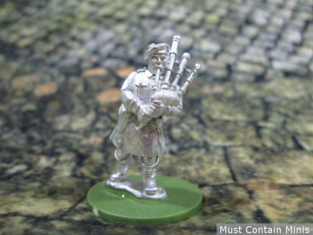 Miniature of a British WW2 Commando taking Bagpipes into battle.