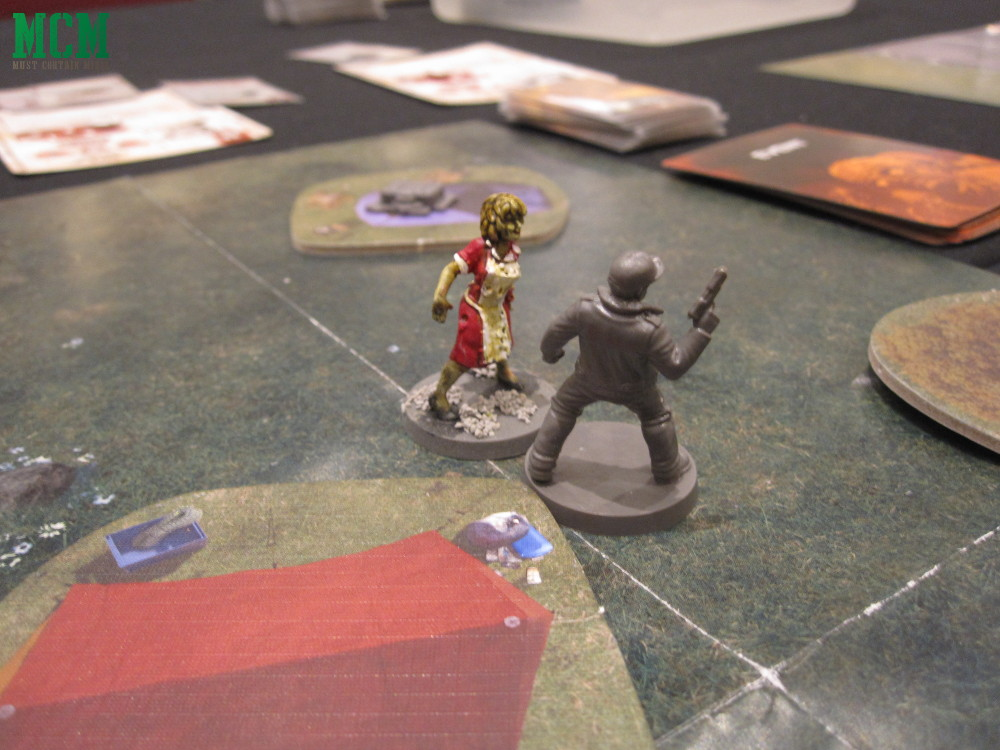 The Walking Dead 28mm Miniature Zombie Game by Mantic Games - Shane vs zombie