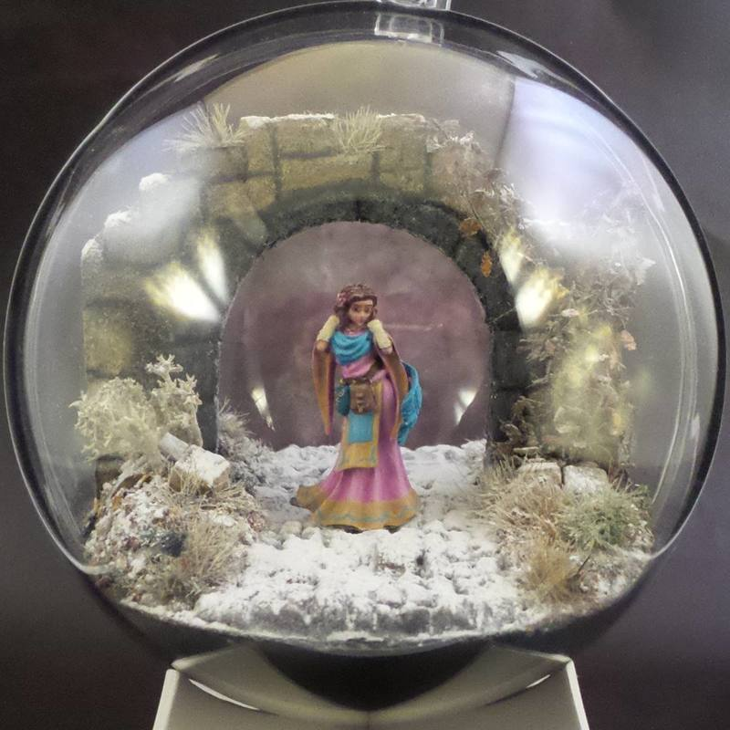 An Elf Cleric in a Snow Globe