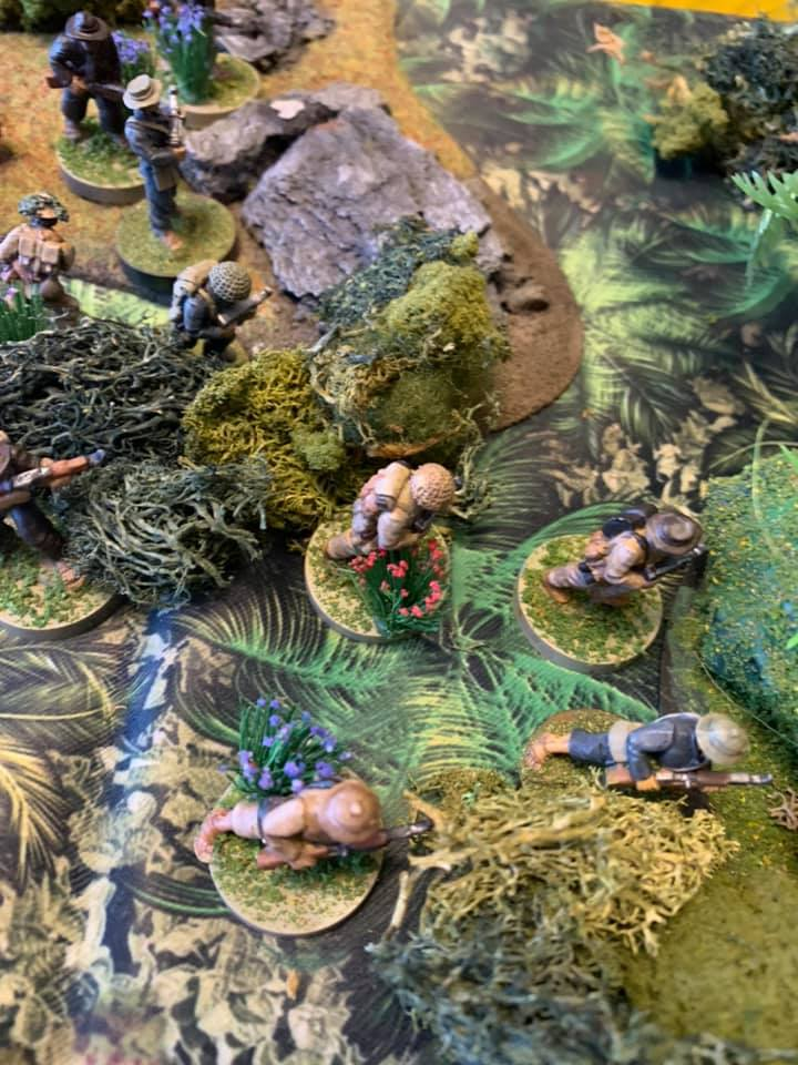 A play test image of troops moving trough the jungle.