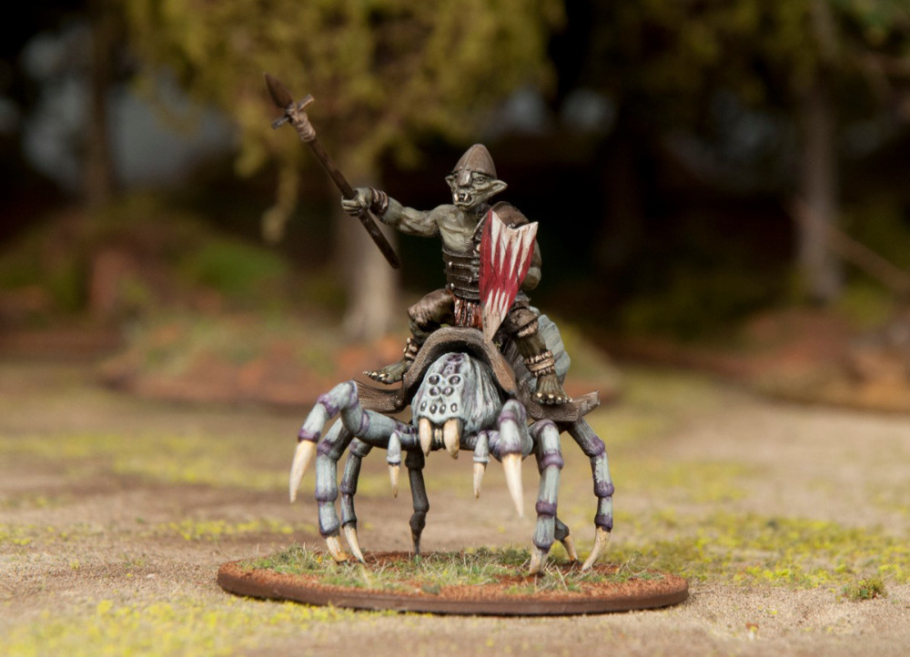 A 28mm miniature goblin rider on top of a spider.
