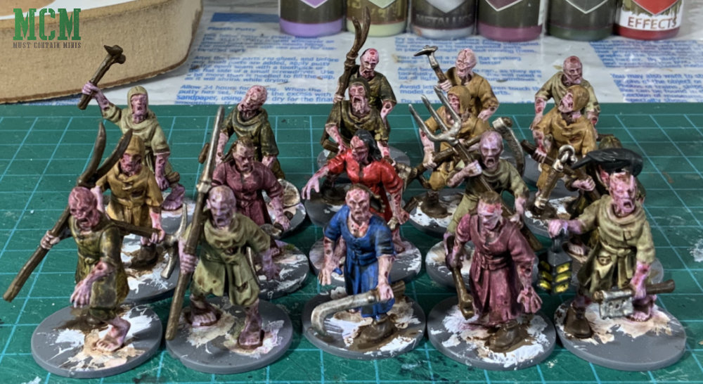 28mm Village Zombies for fantasy games painted and shaded up. Miniatures from Fireforge Games for Forgotten World.