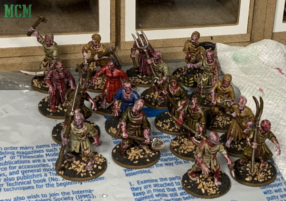 Painted Living Dead Peasants by Fireforge Games.