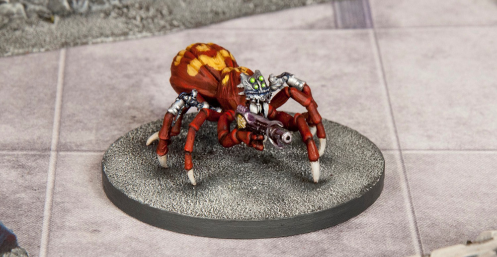 A science fiction Miniature Spider with a gun and cybernetic parts.