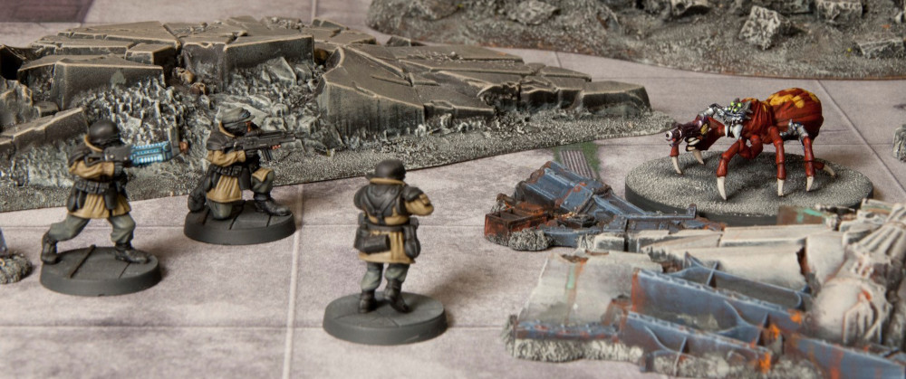 Raujager Infantry take on a Giant Spider with a gun.