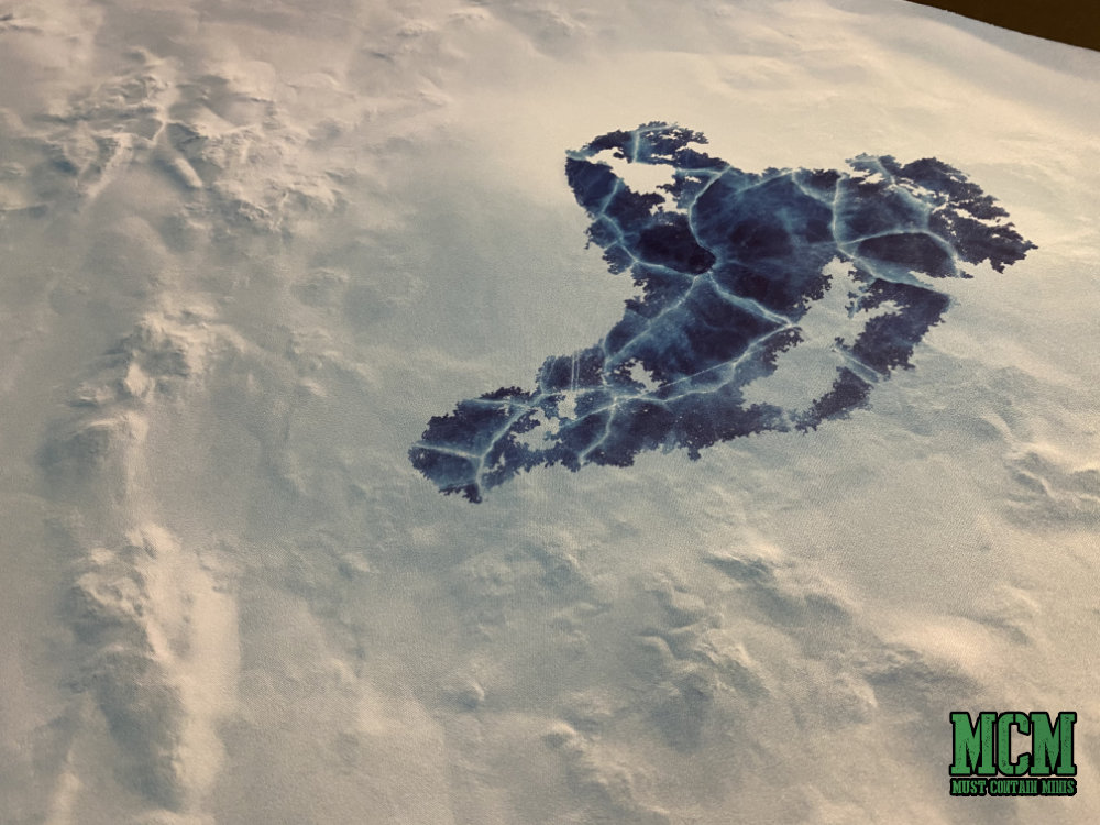 Frozen pond or lake printed on a miniature gaming mat