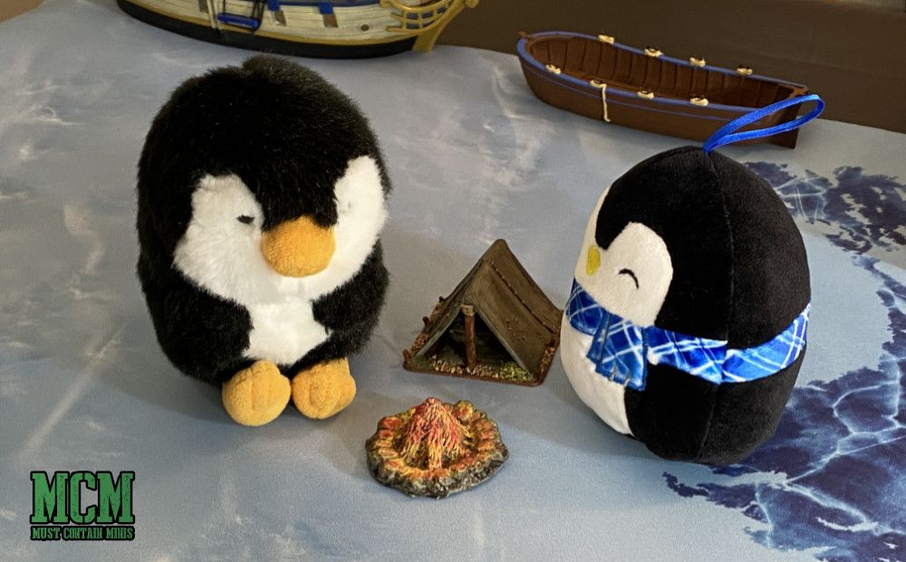 Stuffie Penguins Camp around a Fire Pit and Tent