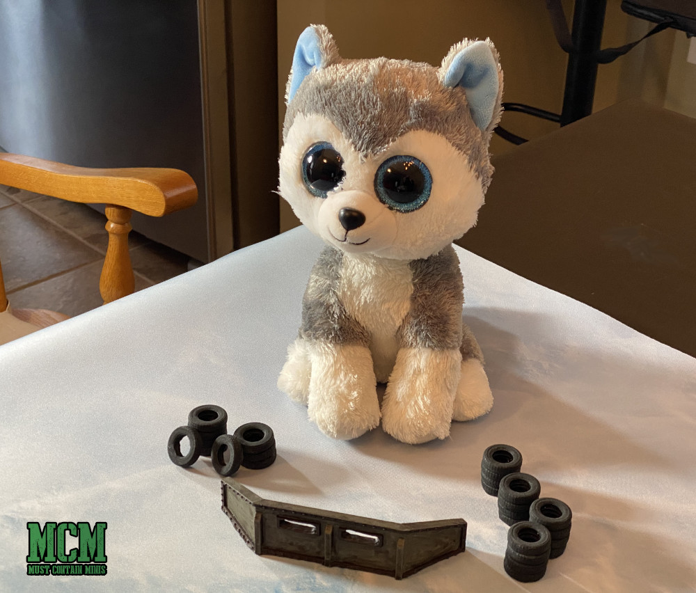 A Husky named King Fortifies his position using gaming terrain by 6 Squared Studios
